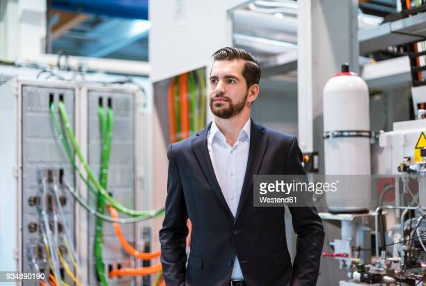 Businessman in factory thinking