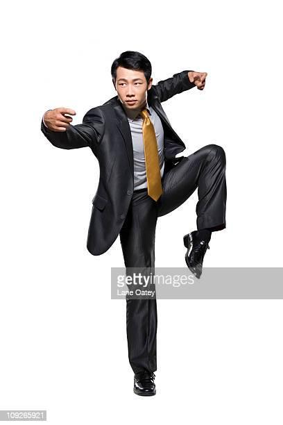 businessman in fighting stance - 背広 ストックフォトと画像