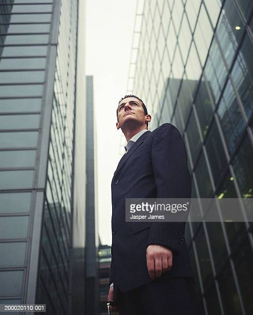 Businessman in financial district, low angle view