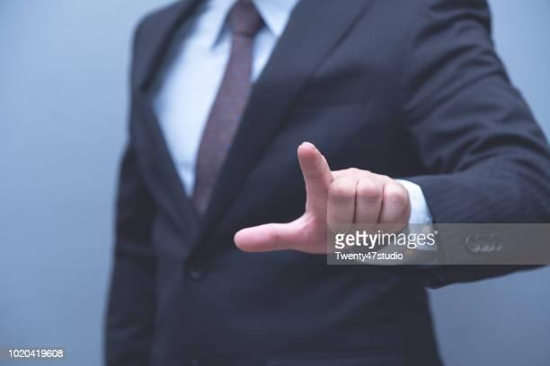 businessman in formal suit pointing on touch screen - berührungsbildschirm stock-fotos und bilder