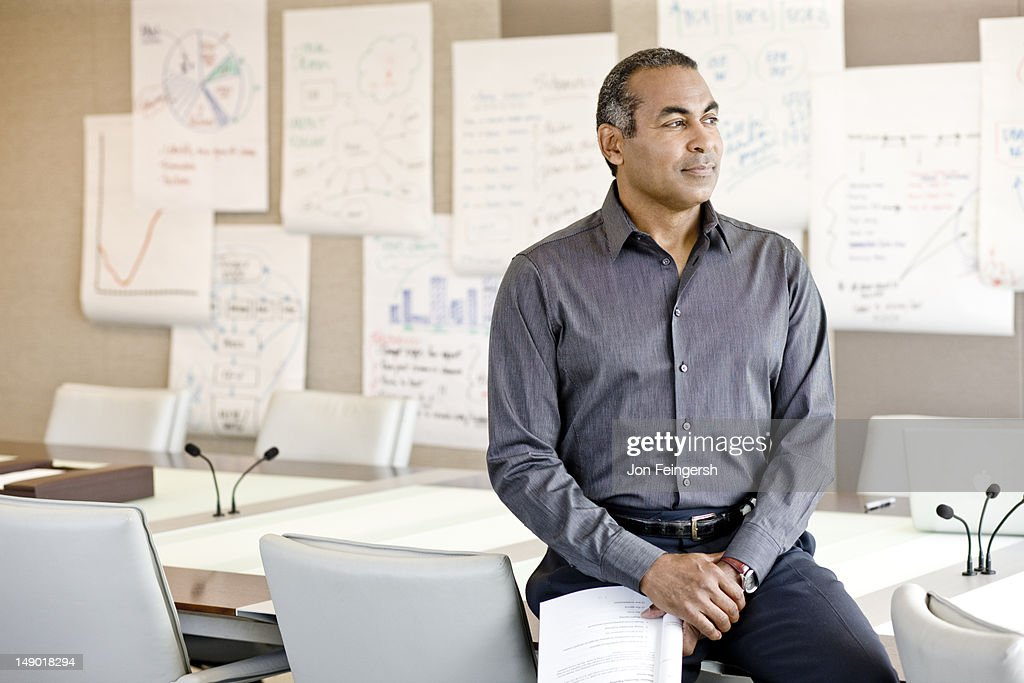 Businessman in front of charts : Stock Photo