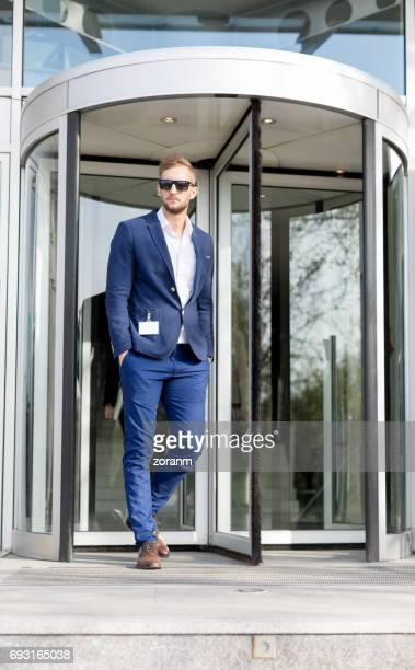 Businessman in front of office building
