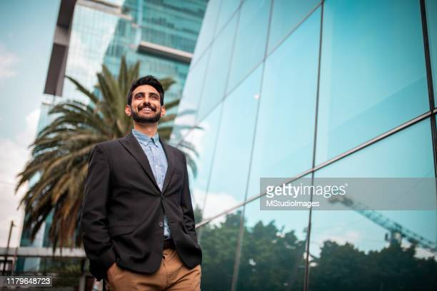 businessman in front of the business center - in front of stock pictures, royalty-free photos & images