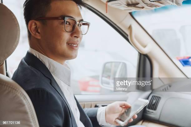 Businessman in Grab Taxi Kuala Lumpur Malaysia