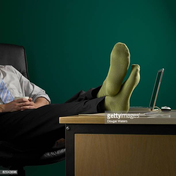 businessman in green socks. - sock stock pictures, royalty-free photos & images