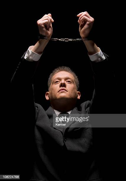 businessman in handcuff - caught cheating stock pictures, royalty-free photos & images