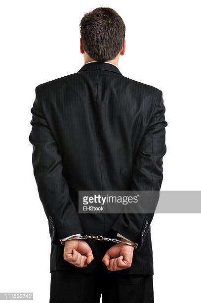 Businessman in Handcuffs From Behind