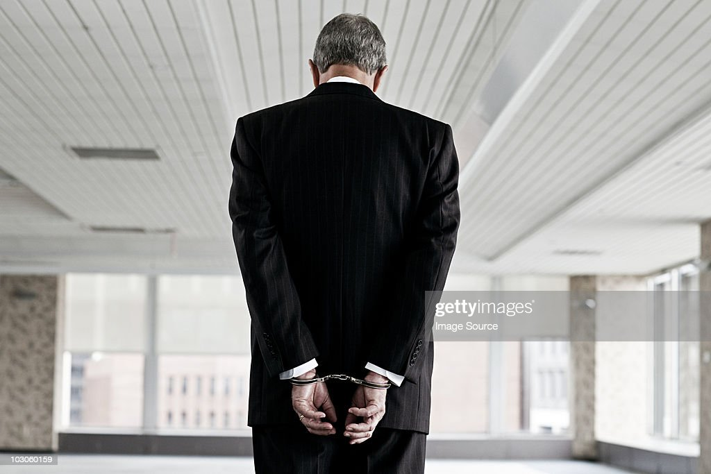 Businessman in handcuffs : Stock Photo