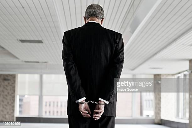 businessman in handcuffs - crime stock pictures, royalty-free photos & images