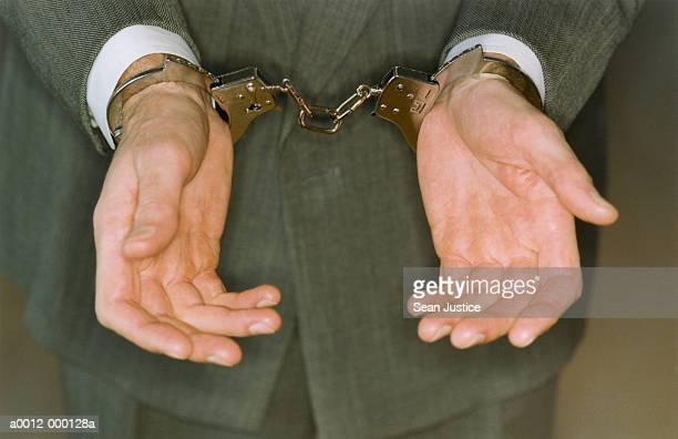 businessman in handcuffs - arrest stock pictures, royalty-free photos & images