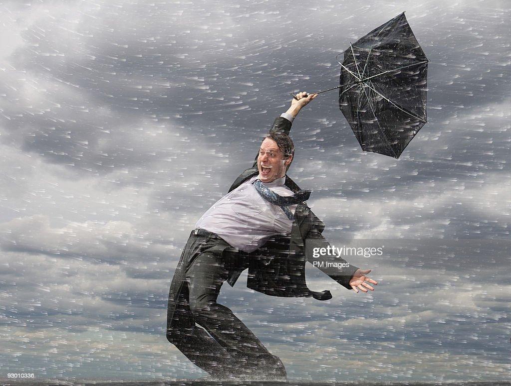 Businessman in Hurricane  : Stock Photo