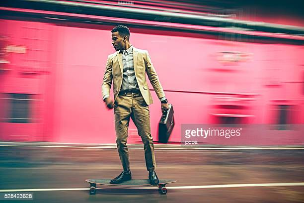 businessman in hurry on longboard