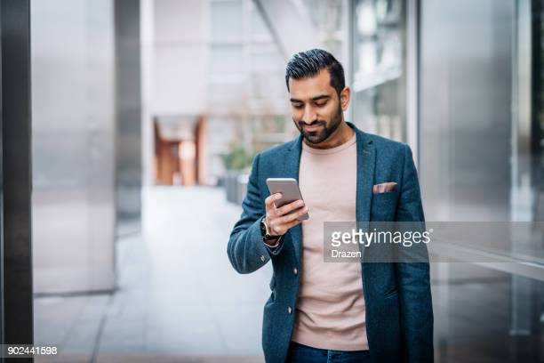 Businessman in India using new mobile app
