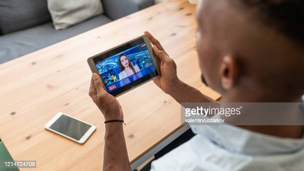 businessman in isolation watching newscaster presenting the breaking news during in a state of emergency - the media stock pictures, royalty-free photos & images