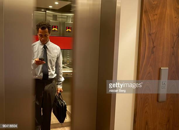 Businessman in lift.