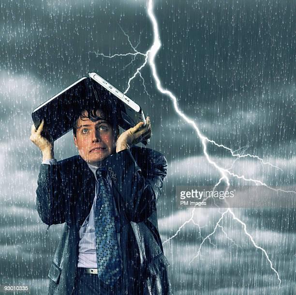 Businessman in lightning storm