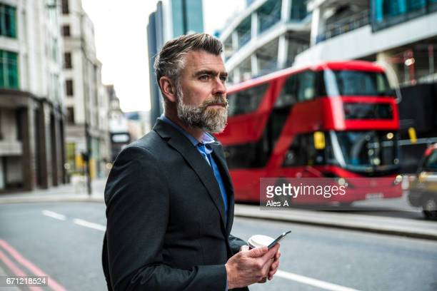businessman in london - red suit stock pictures, royalty-free photos & images