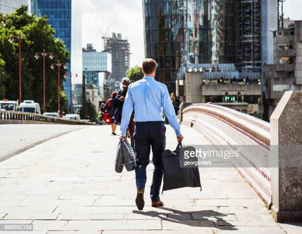 businessman in london - pedestrians stock photos and pictures