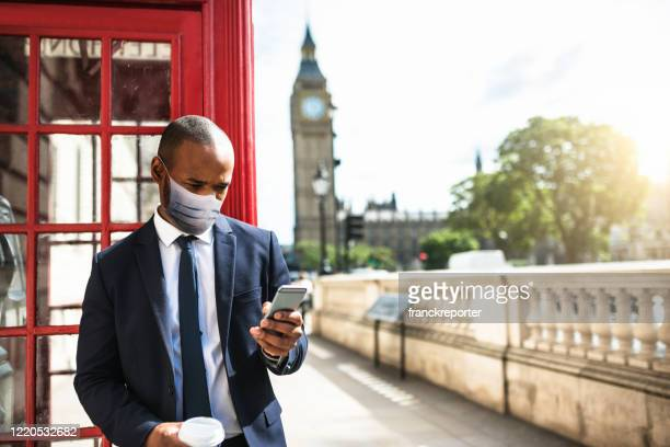 businessman in london with mask - central london stock pictures, royalty-free photos & images