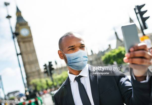businessman in london with mask - corona landmarks stock pictures, royalty-free photos & images