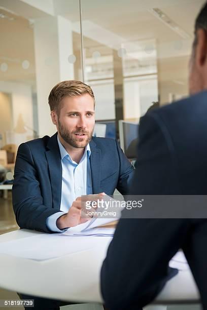businessman in meeting - differential focus stock pictures, royalty-free photos & images