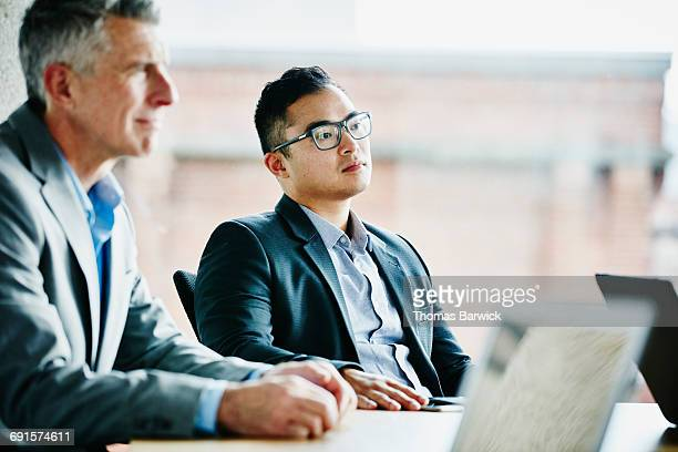Businessman in meeting with coworkers in office