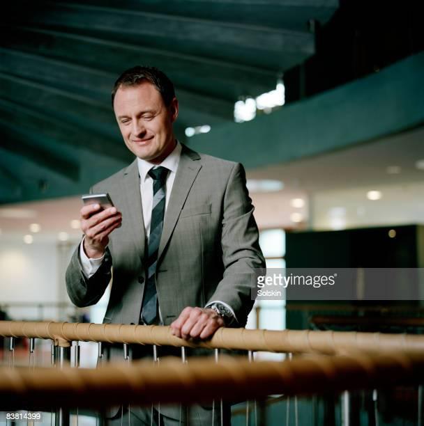 businessman in modern office environment - abbigliamento da lavoro formale foto e immagini stock