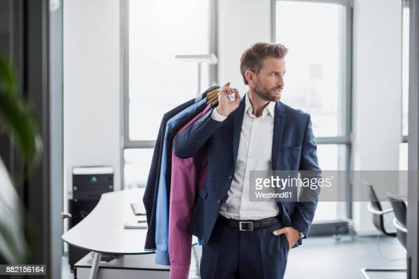businessman in office carrying shirts - dry cleaner stock pictures, royalty-free photos & images