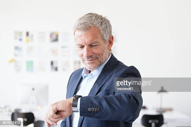 Businessman in office checking the time