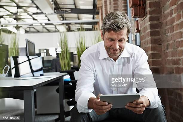 Businessman in office looking at digital tablet