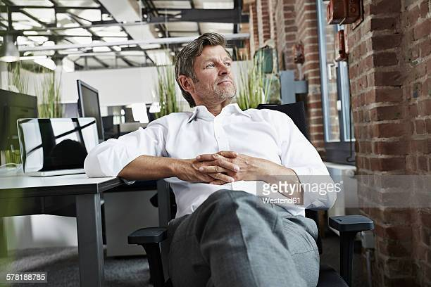Businessman in office looking to the side