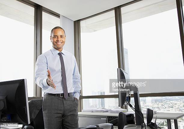 Businessman in office offering hand for handshake