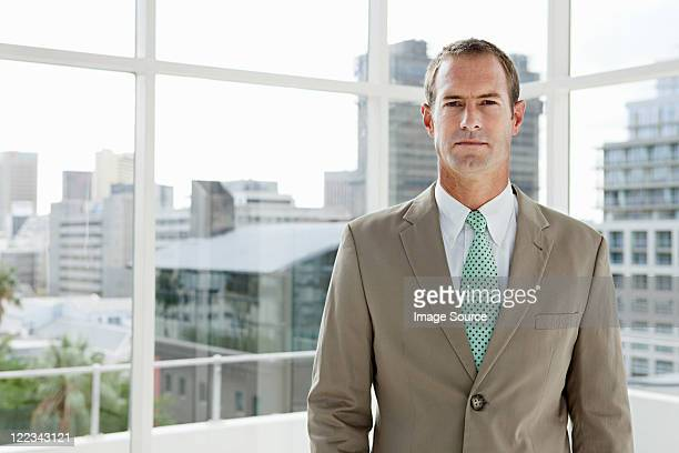 businessman in office, portrait - beige suit stock pictures, royalty-free photos & images
