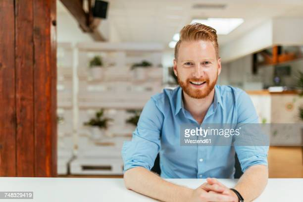 Businessman in office sitting at desk