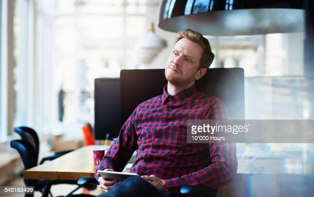 Businessman in office thinking about project