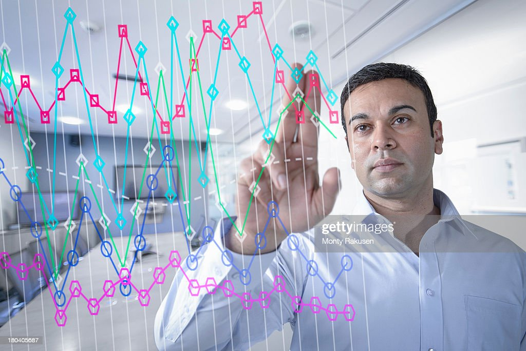 Businessman in office using interactive screen : Stock Photo