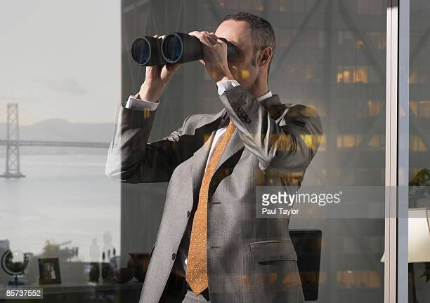 Businessman in office with reflection