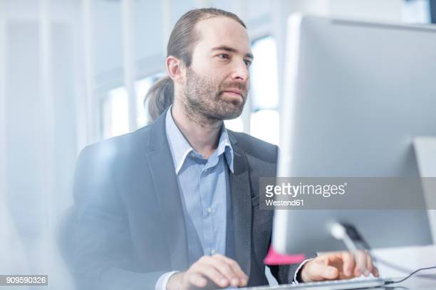 Businessman in office working on a computer