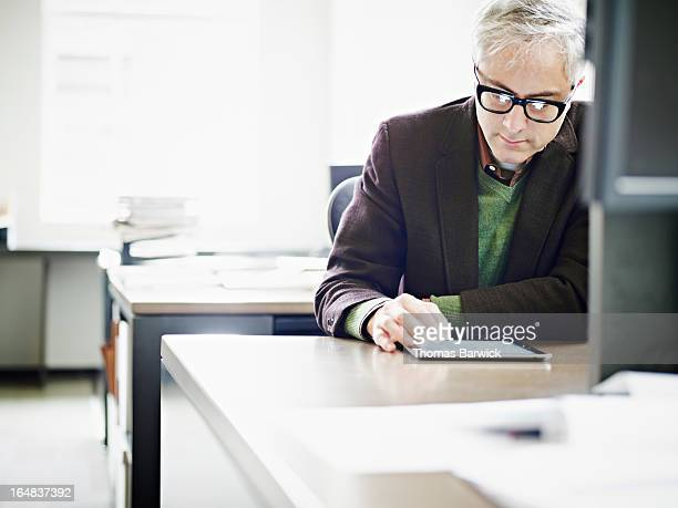 Businessman in office working on digital tablet