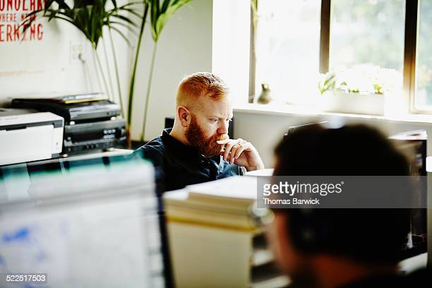 Businessman in office working on project on laptop