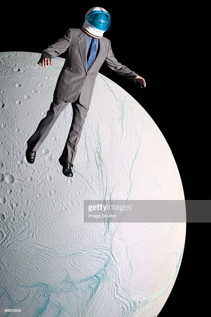 Businessman in outer space : Stock Photo