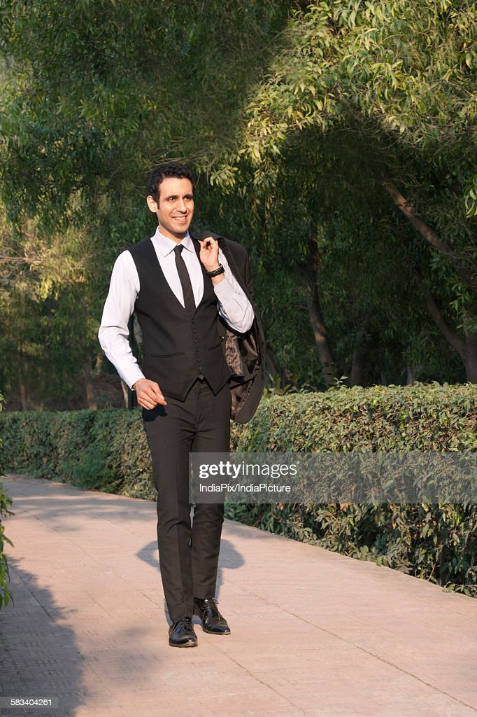 Businessman in park smiling , INDIA , DELHI : Stock Photo