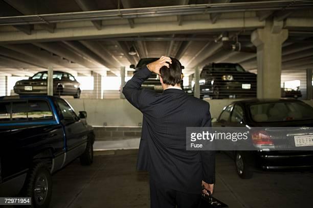 Businessman in parking garage
