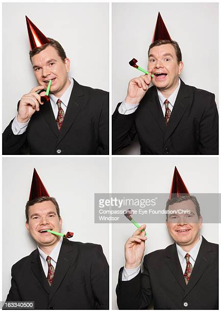 Businessman in photo booth wearing party hat