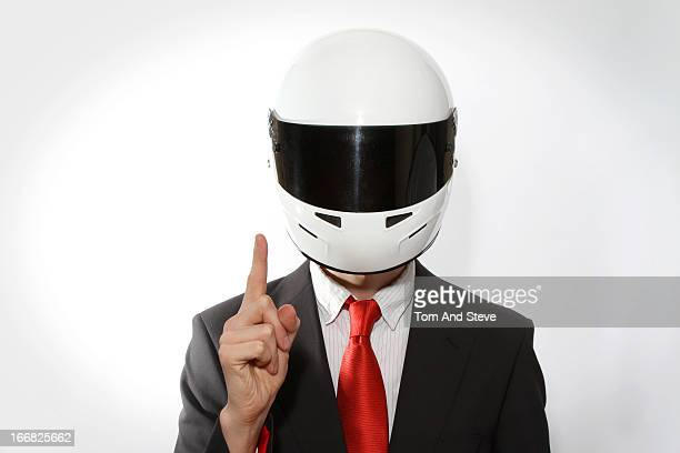 Businessman in racing driver helmet