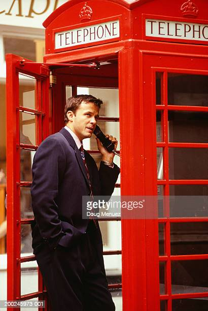 businessman in red phone booth - telephone box stock pictures, royalty-free photos & images