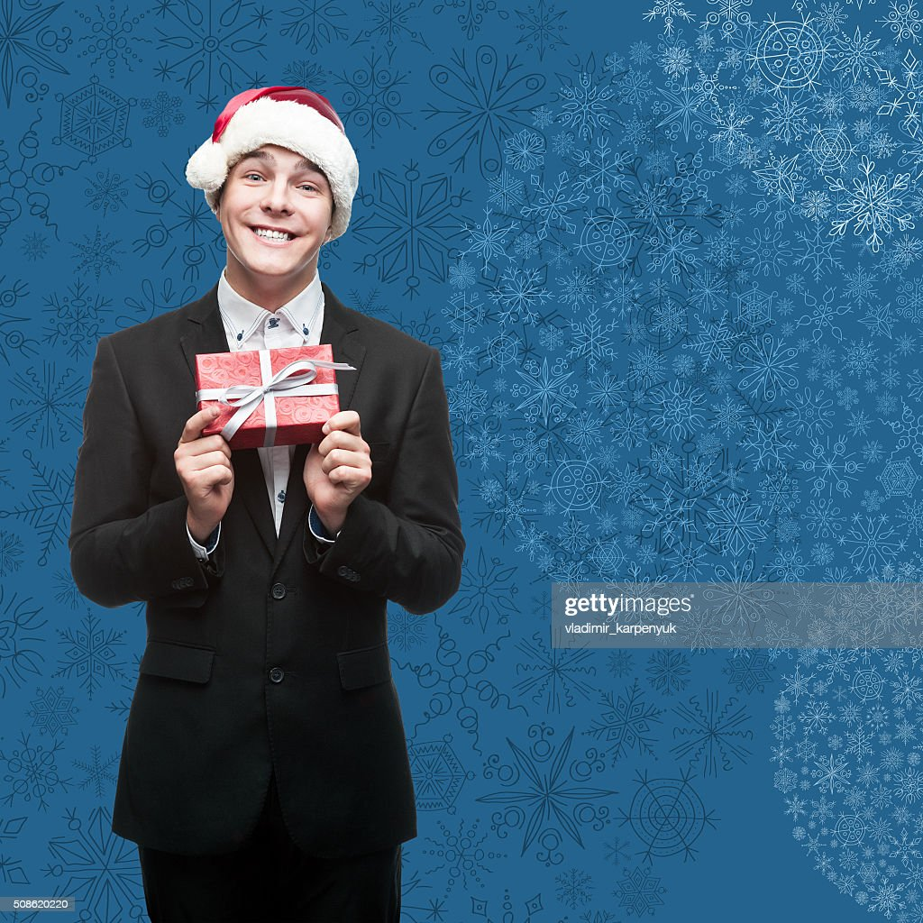 businessman in santa hat holding gift : Stock Photo