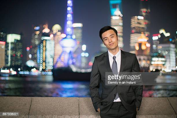 Businessman in Shanghai at night.