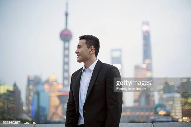 Businessman in Shanghai, China at night