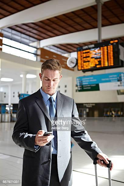 Businessman in station foyer